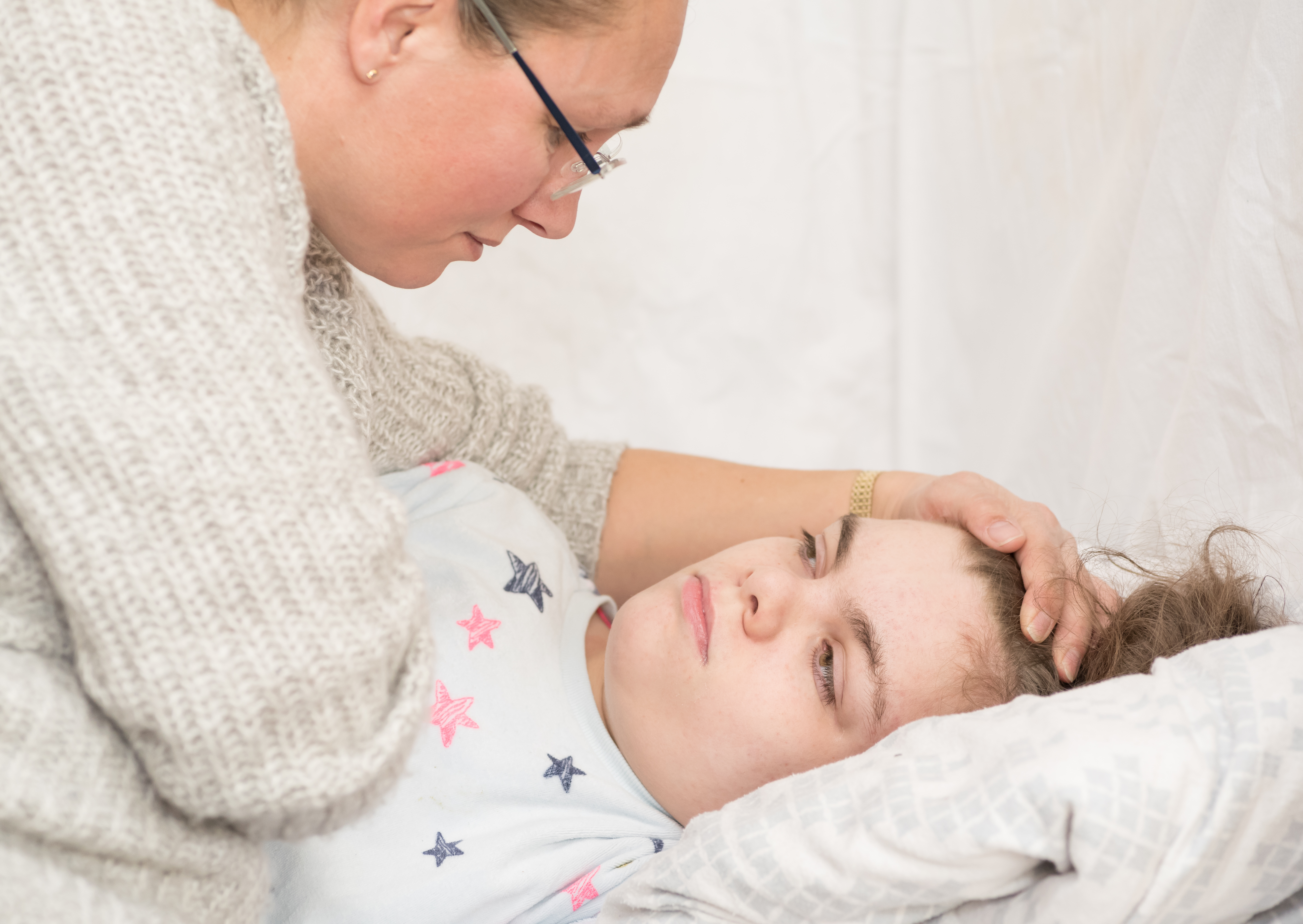 A Child Being Cared For During An Epileptic Seizure By A Qualifi